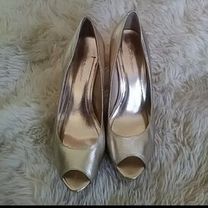 BCBGeneration gold peep toe pumps